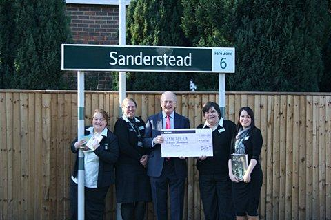 Station staff presenting Diabetes UK president Richard Lane with the cheque