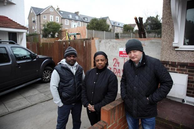 Grantley and Brenda George with their neighbour John Skinner