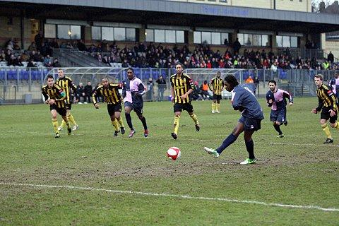 Man in demand: Danny Carr scores one of his many goals for Dulwich Hamlet   SP72946