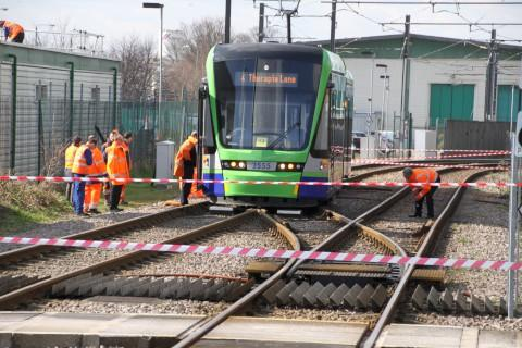 Engineers inspect derailed tram near Therapia Lane. Photo credit: Desmond FitzGerald