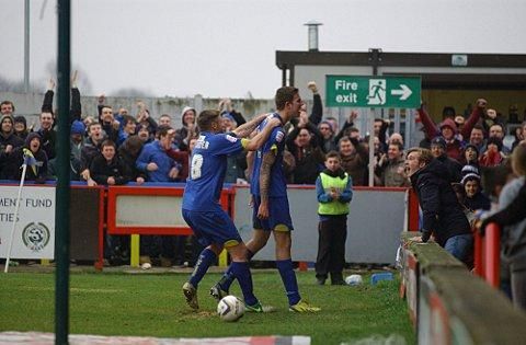 Happy days: Celebration time at Kingsmeadow in the 3-2 win over York on Saturday     SP74681
