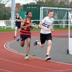 Runner-up: Keiron Connor, right, on his way to second place in the U15 boys' 1,500m