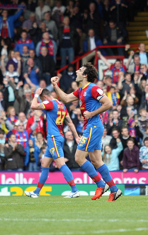 Captain marvel: Mile Jedinak celebrates his goal in the 3-2 win over Peterborough on Saturday     SP72957
