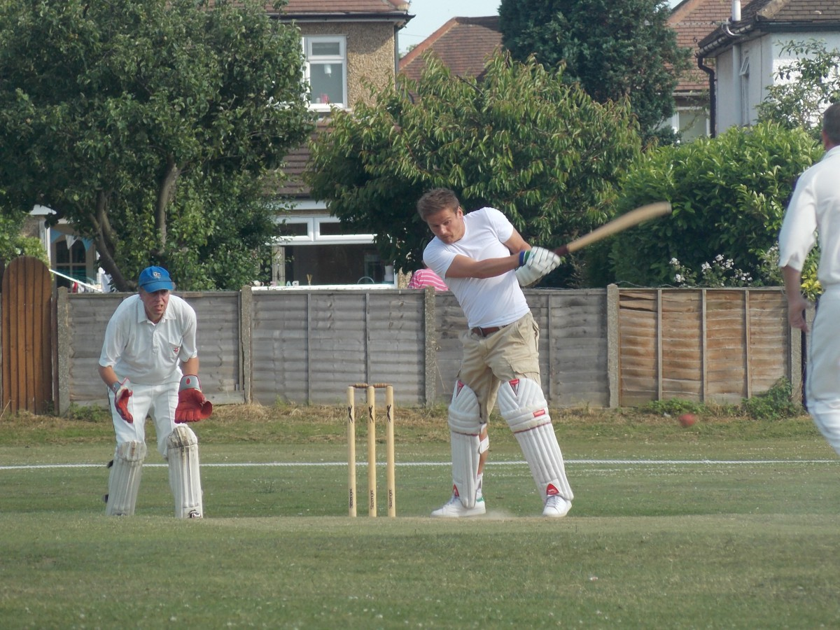 Neal Ardley tries his hand with the cricket bat