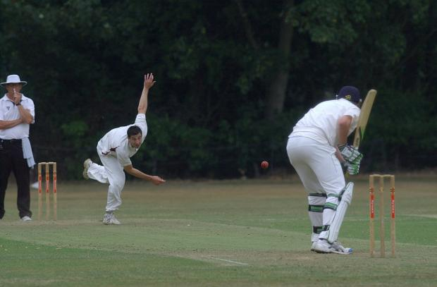 Fast pace: Malden Wanderers' Michael Cottrell attacks the Guildford top order, eventually taking 1-18              SP73118