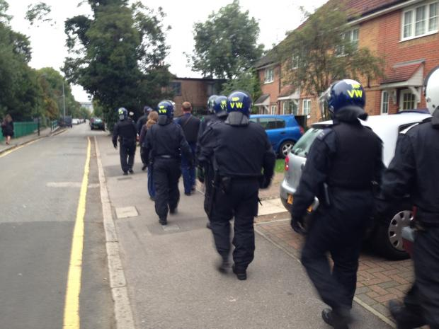 Officers during one of the south London raids
