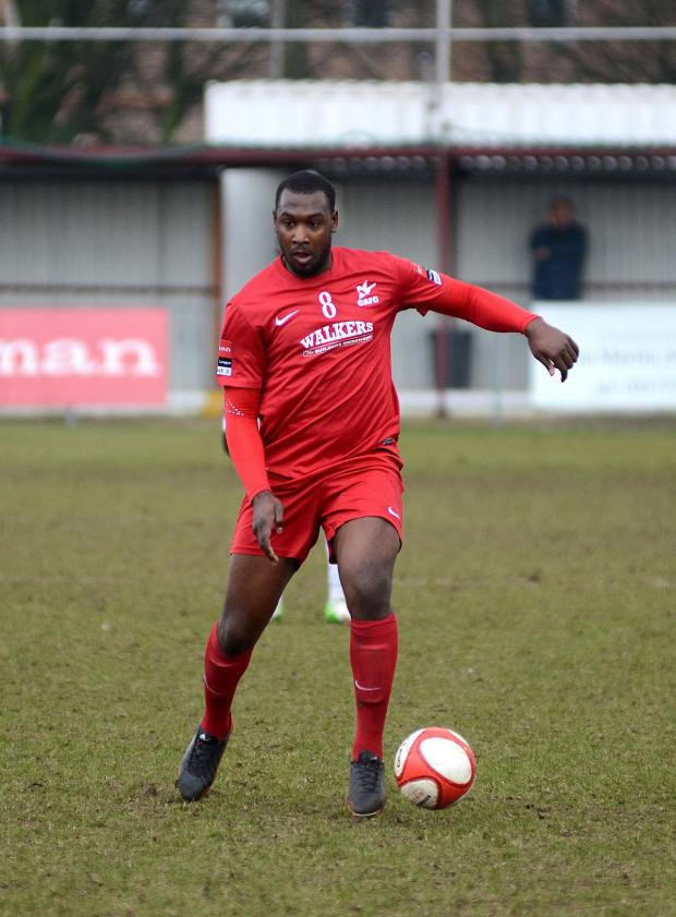 Croydon Guardian: Hakeem Adelakun playing for Carshalton Athletic