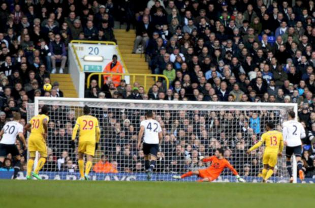 Whoops: Jason Puncheon's penalty at Spurs begins the long trip into orbit