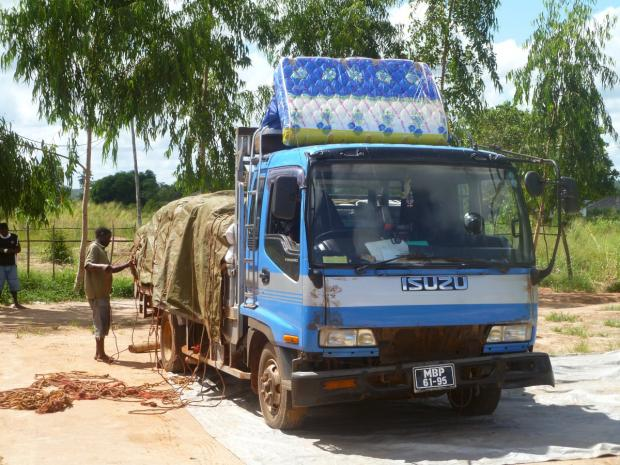 Croydon Guardian: Travel in Mozambique is often limited to travelling on the back of flat-bed trucks on top of cargo