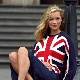 Croydon Guardian: Kate Moss poses for the media for the start of London Fashion Week in 1997