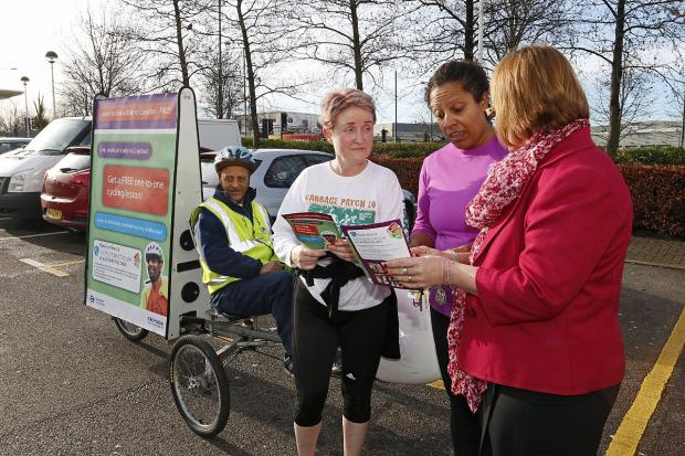 Croydon Council road safety officer Susan Martin talks to Eileen Leonard and Chris Ajayi about free cycle training.