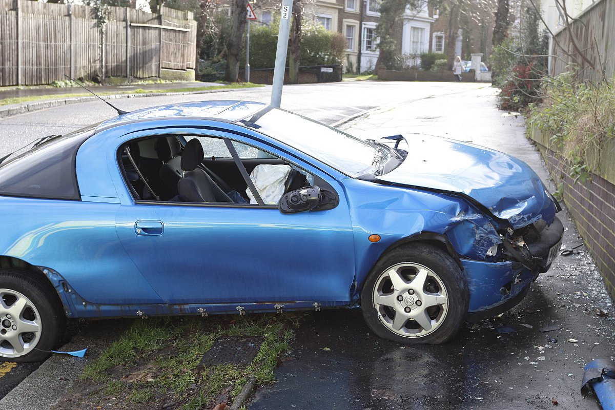Woman crashes car front-first into wall - but walks away without serious injury