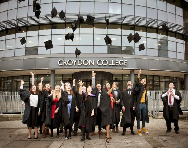 University Centre Croydon graduates celebrate outside Croydon College