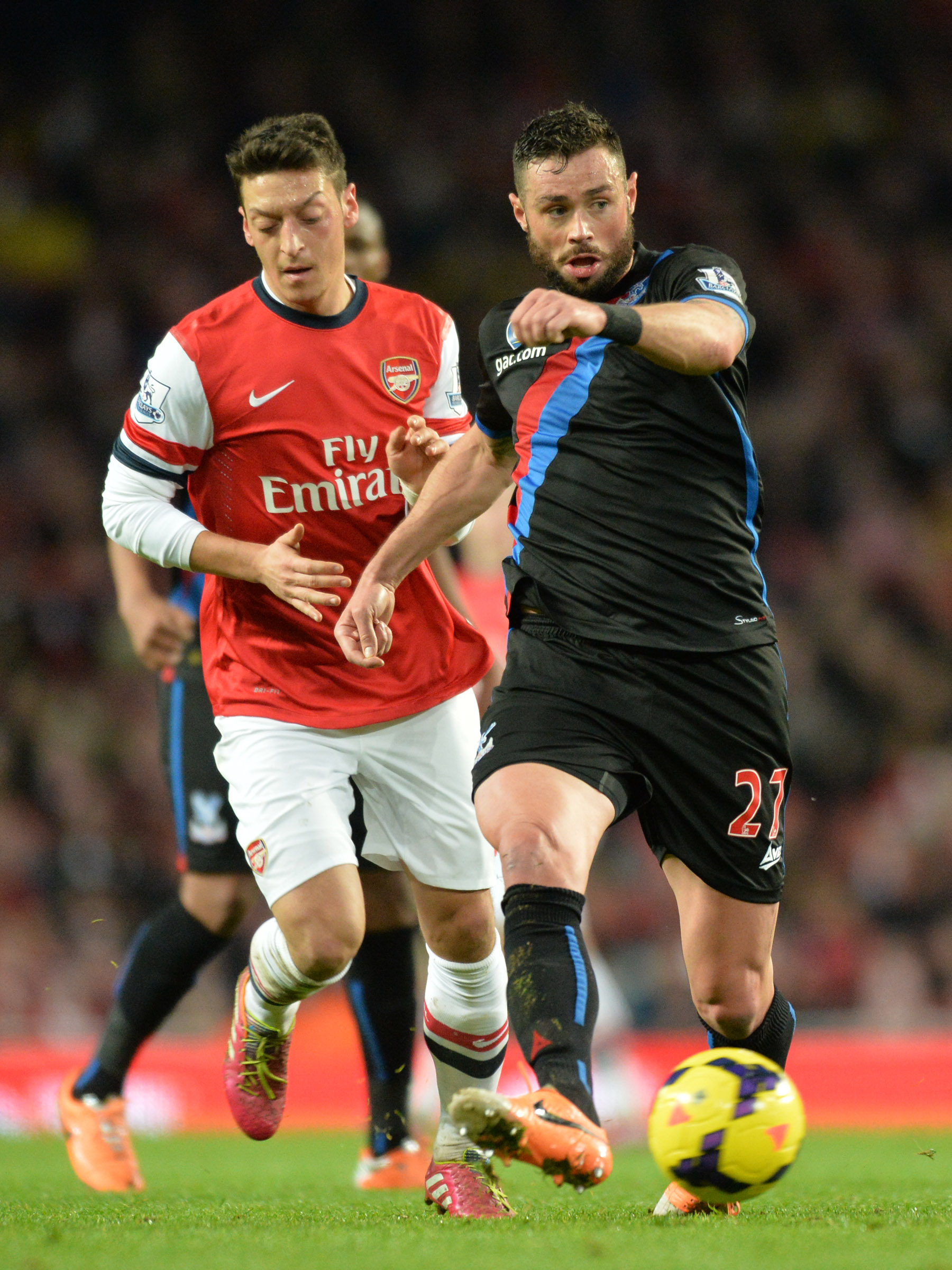 Croydon Guardian: The Eagles defender gets the better of German star Mesut Ozil at the Emirates. PICTURE BY KEITH GILLARD.