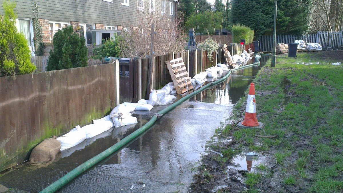 Homes in Bourne Park Close, Kenley, are using sandbags to try and keep the water at bay.