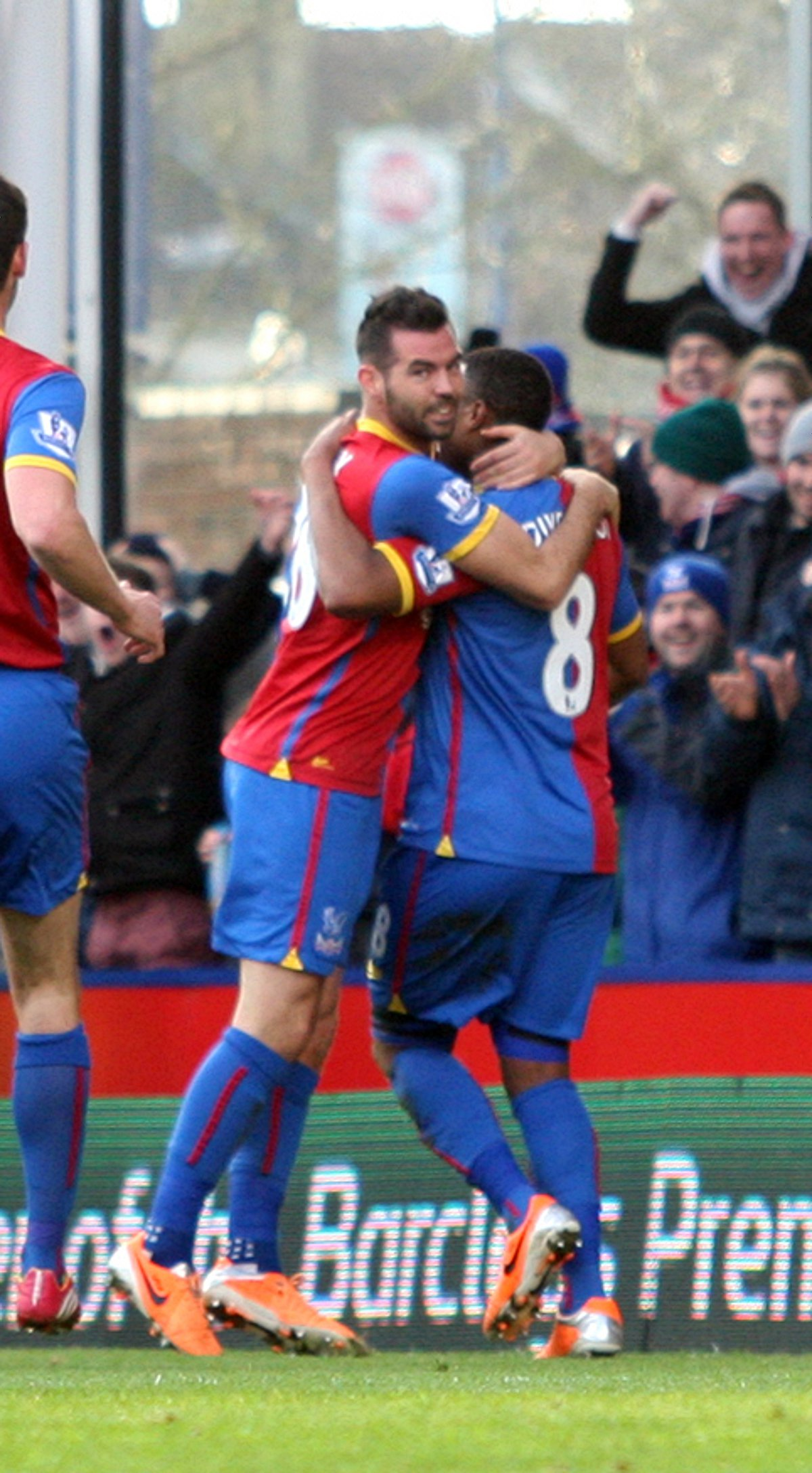 Brothers in arms: Joe Ledley celebrates a debut goal with Tom I
