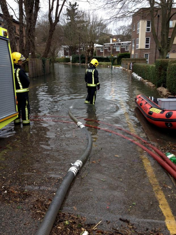Croydon Guardian: Firefighters have brought in rescue dinghies in case anyone needs to be taken to safety. Picture courtesy of Bethany Taylor