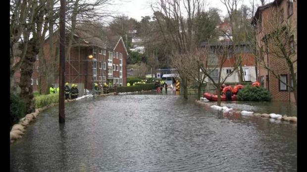 Sandbags are being used to try and stop flooding into homes in Dale Road. Picture by Alastair Snell