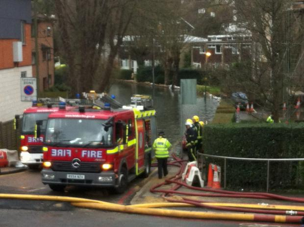 Firefighters in Station Approach near Dale Road, Purley, yesterday. Photo by Ted Hall