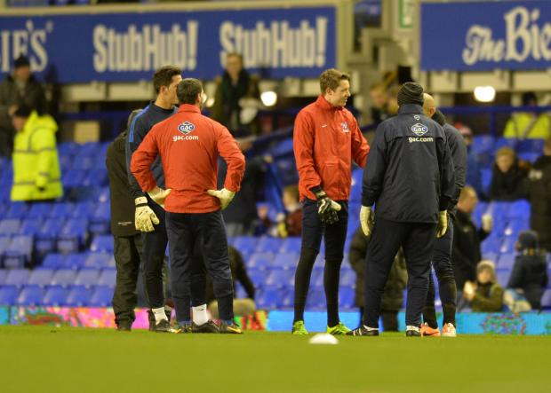 Croydon Guardian: Palace players warm up before the game was cancelled