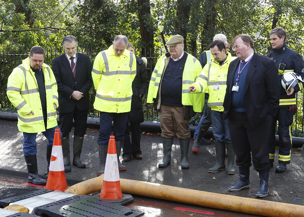 Communities Secretary Eric Pickles wore a flat cap on his tour of flood stricken Croydon South