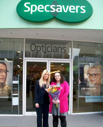 Glasses wearer Louise Murie visits Specsavers to say thank you to optometrist Miriam Conlon