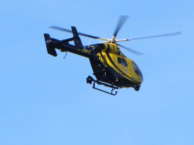 A Metropolitan Police helicopter is involved in the search
