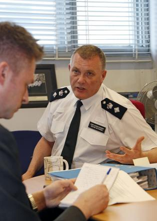 Chief Supt Dave Musker speaking to Croydon Guardian chief reporter Robert Fisk