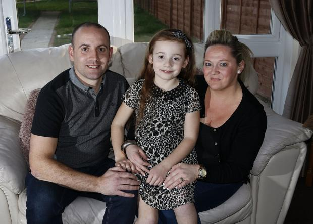 Croydon Guardian: Scarlett with her parents John and Lisa Hewitt