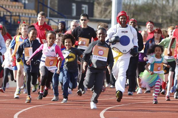 Runners at the Sport Relief mile at Croydon Arena