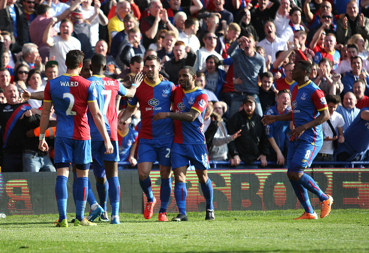 Happy times: Palace celebrate the winner over Chelsea, scored by the