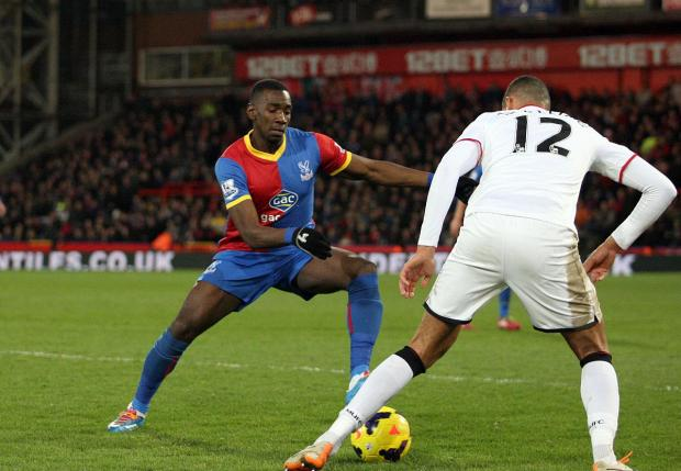 Pocketing the points: Yannick Bolasie and team-mate Jason Puncheon gave the Chelsea defenders a torrid time on Saturday