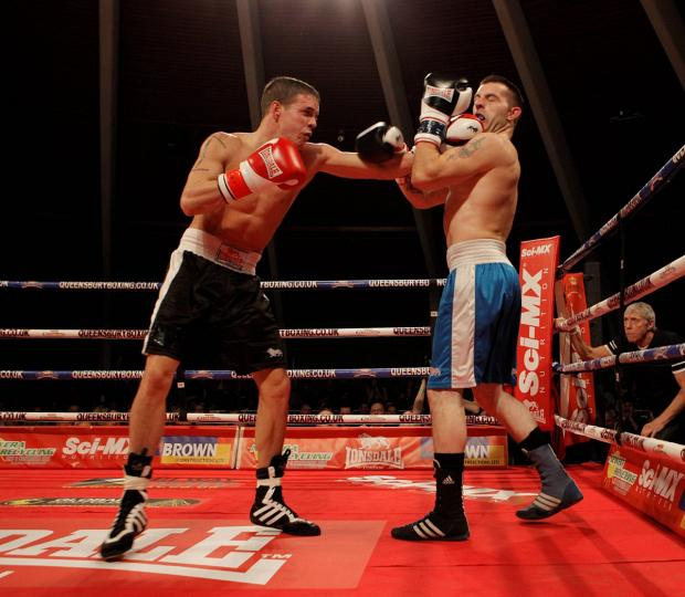 Croydon Guardian: Not the real deal: Jimmy Mizon, left, ultimately lost this QBL bout against Dan Spencer, and it has taken him more than a year to get back into the ring 	Picture: Alan Foley