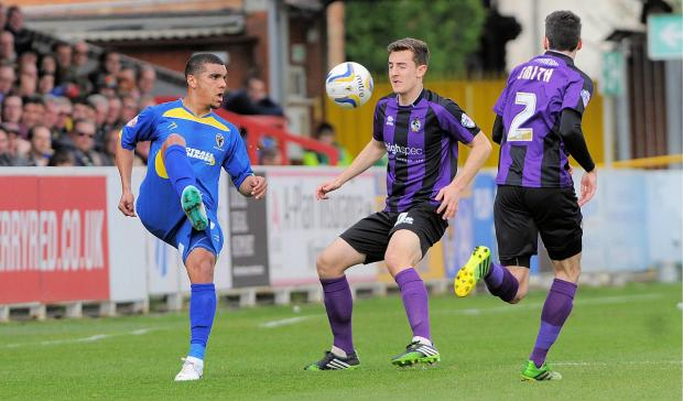 Croydon Guardian: In the blue: Kwesi Appiah in AFC Wimbledon colours during the League Two 0-0 draw against Bristol Rovers                Picture: David Purday