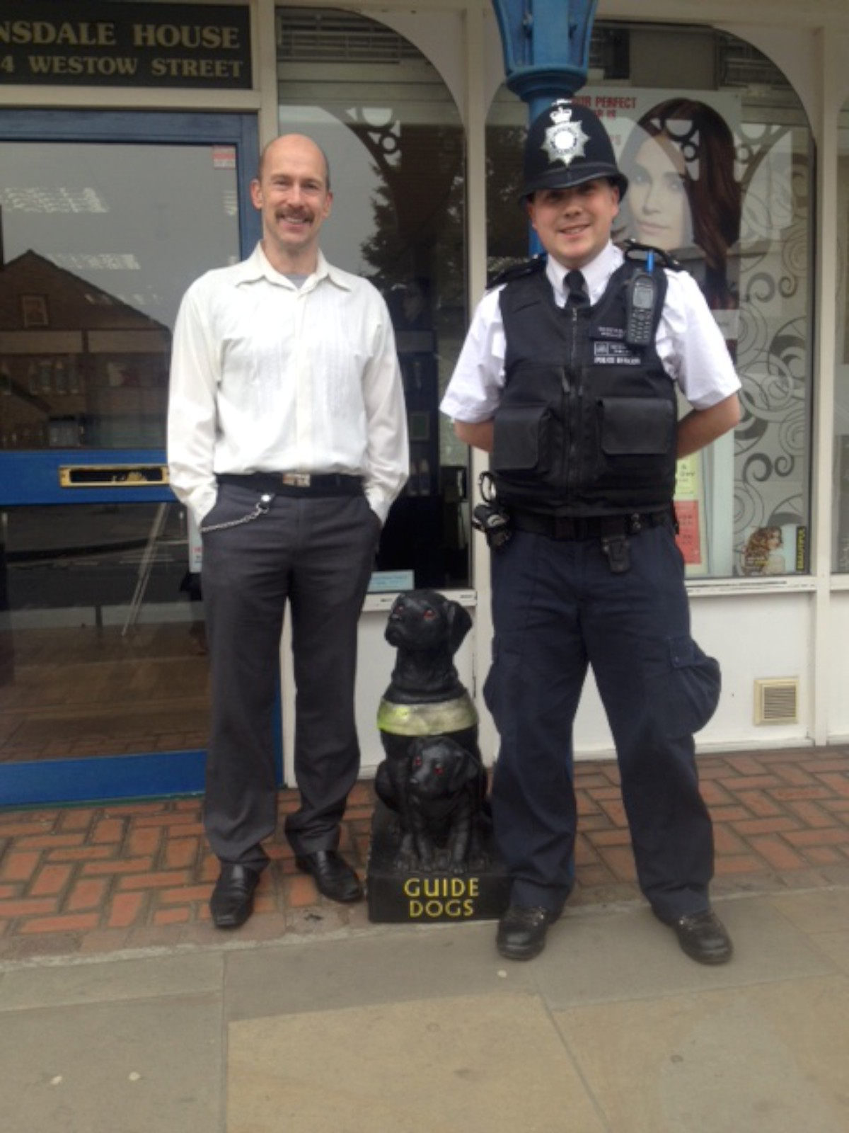 PC Woolley has returned the Guide Dogs for the Blind charity collection box to the owner of the hair salon