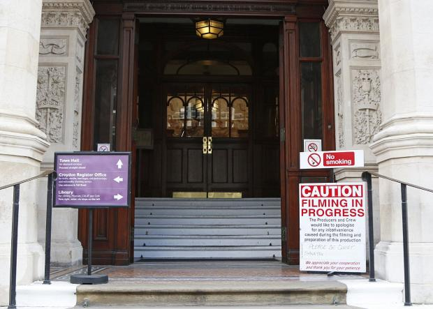 Croydon Guardian: The sign warns people to be quiet when entering the town hall