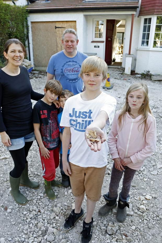 Croydon Guardian: The Carpenter family - mum and dad Alison and Michael and their children Jasmine, 11, Joel, 9, Toby, 7, and Zac, 13, holding bone fragments
