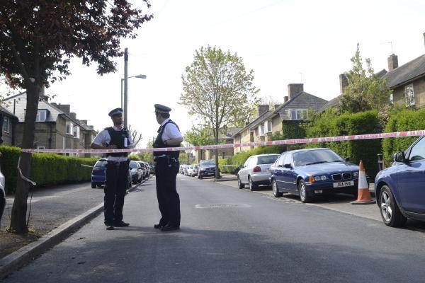 Police in Huntingfield Road, Roehampton, on Wednesday morning
