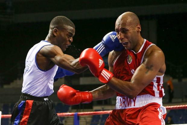 Unstoppable: Joshua Buatsi, left, defeating Tom Barry in