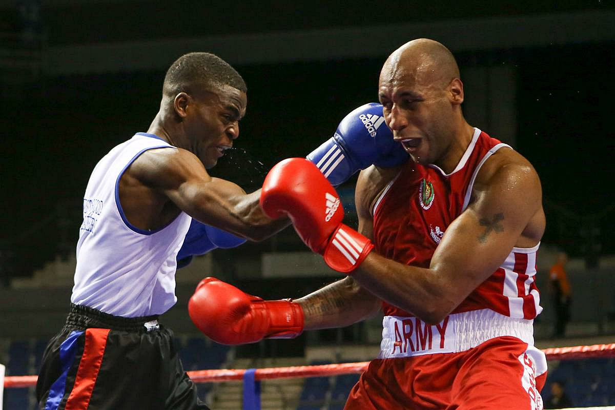 Unstoppable: Joshua Buatsi, left, defeating Tom Barry in the semi-finals of the England Boxing Elite Championship, en route to becoming the English champion