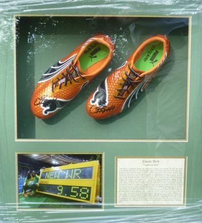 The running shoes were framed along with a photo of Bolt