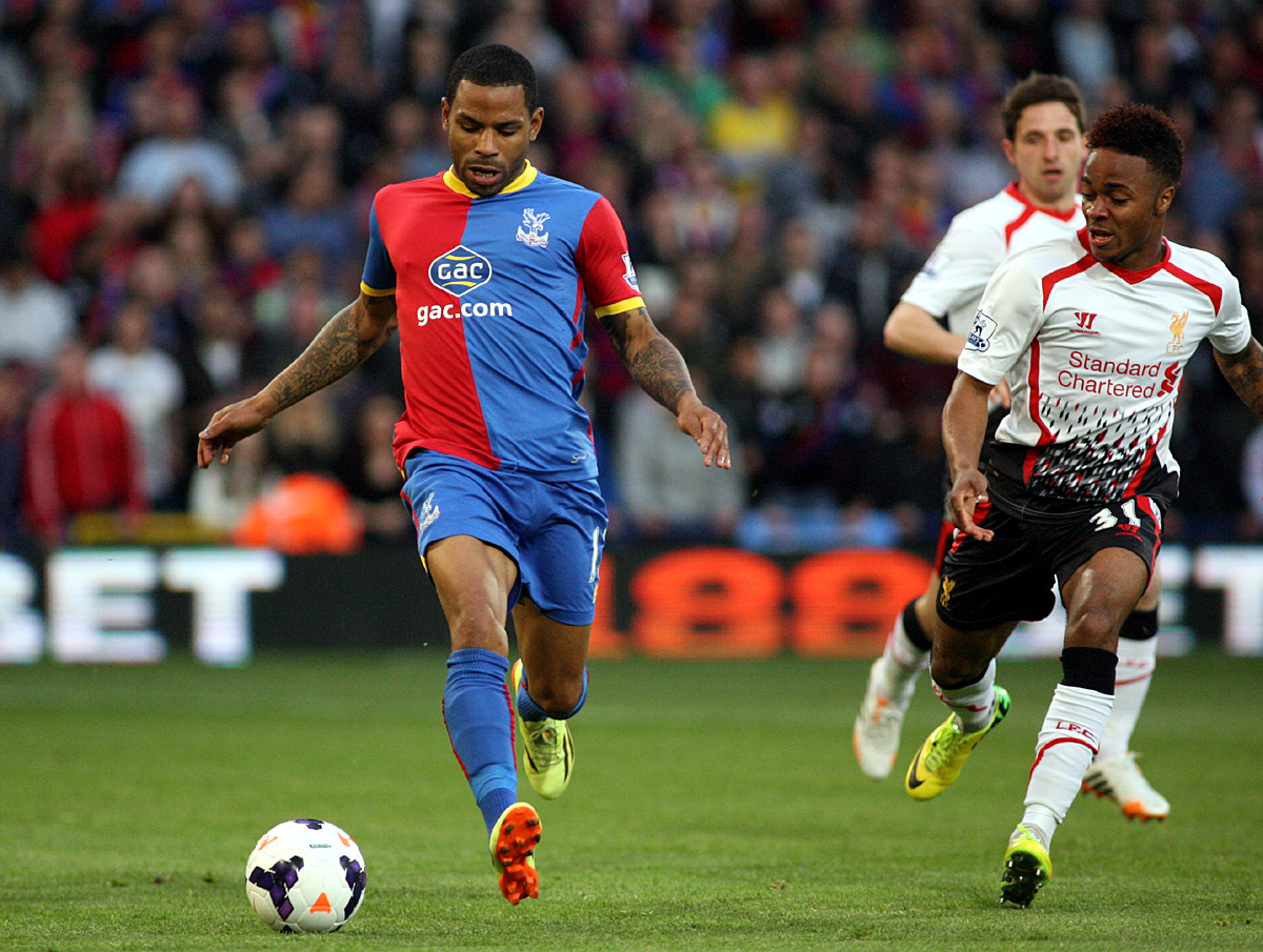Croydon Guardian: Jason Puncheon tries to get away from Raheem Sterling