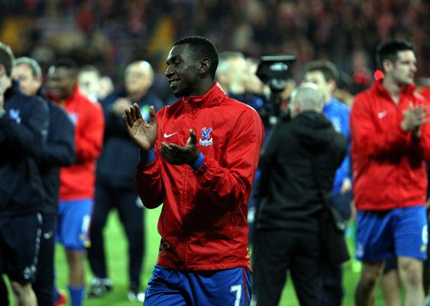 Croydon Guardian: Yannick Bolasie applauds the Palace fans after Monday's 3-3 draw with Liverpool. Picture by Edmund Boyden.