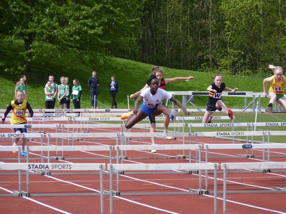 Lily B League action: Marcia Sey takes on the hurdles for Croydon Harriers