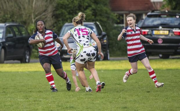 Tough night: Elicia Davis of Rosslyn Park attacks the Moody Cows, with Danielle Williams in support