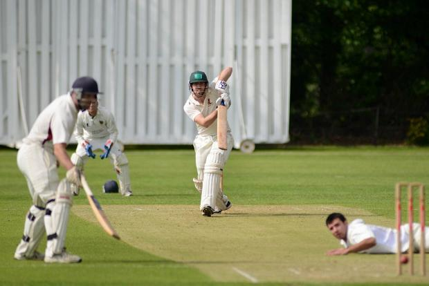 In vain: Malden Wanderers Will Sabey hits out against Cranleigh but his side fell four runs short of victory