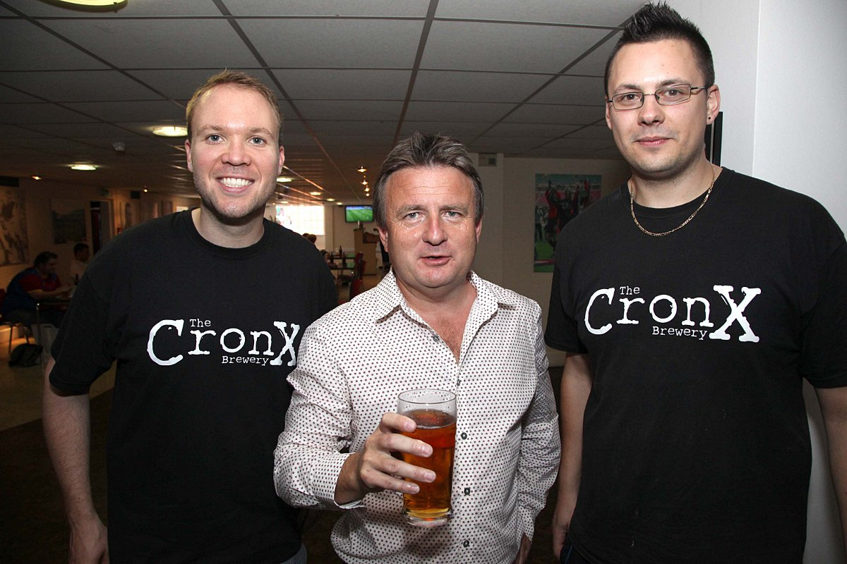 Cheers: Steve Browett flanked by the Cronx brewers, Simon Dale and Mark Russell
