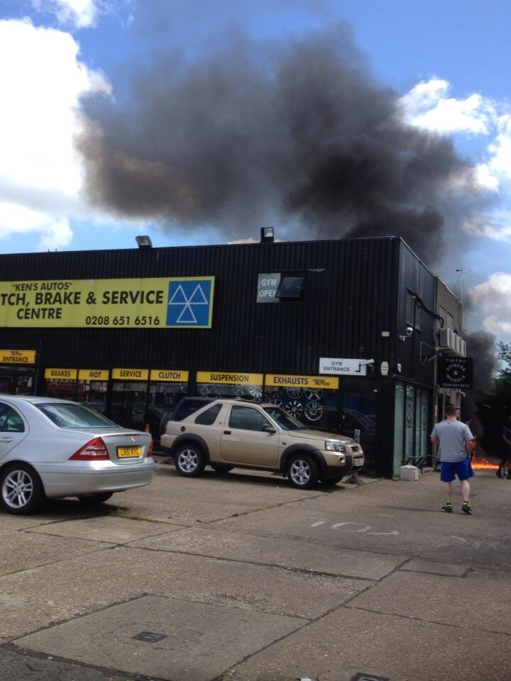 Fire was reported at Ken's Autos at 11.16am (photo: Jordan Batts)