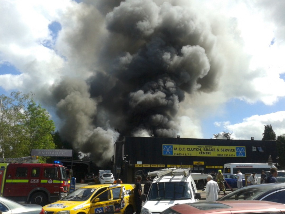Smoke billows out of Ken's Autos yesterday