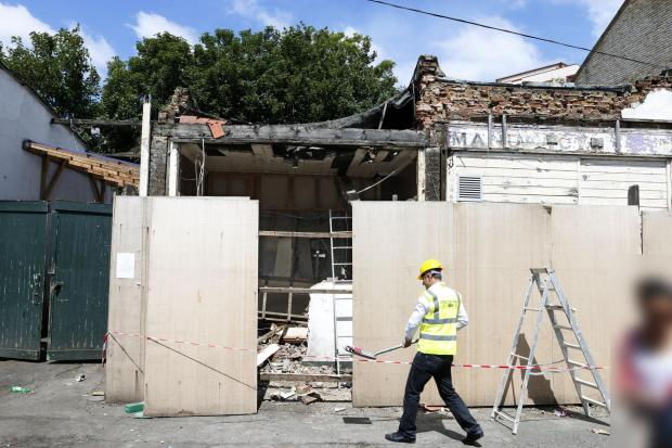 Contractors have begun to demolish surrounding buildings